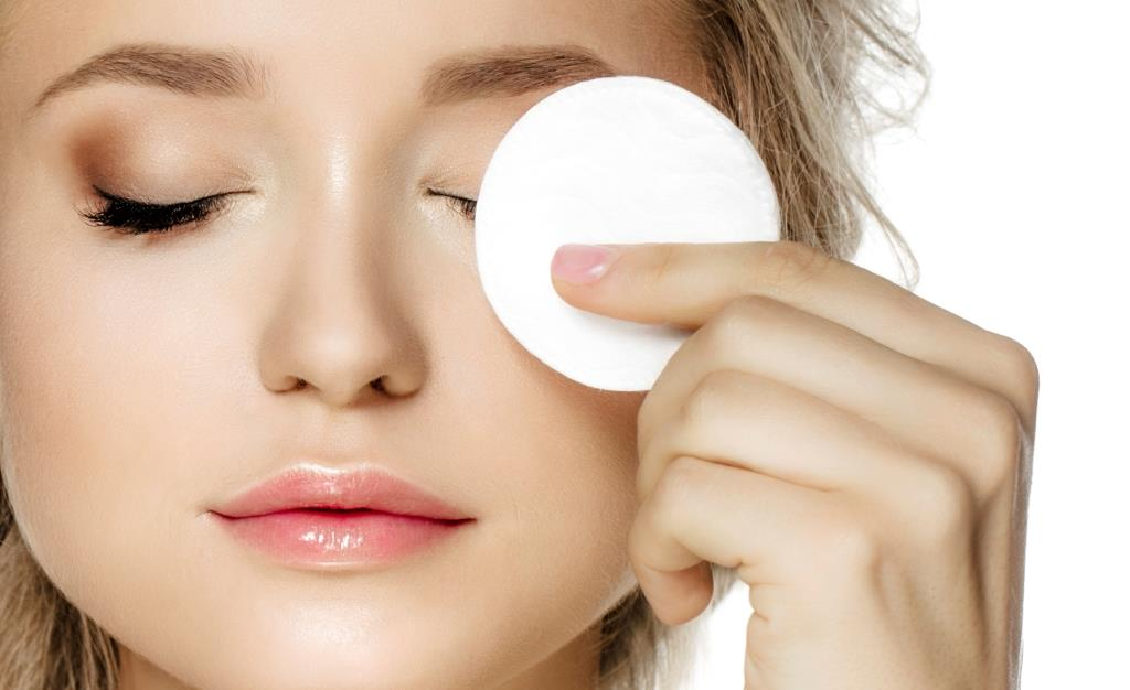 Beauty Myths - Woman wiping face