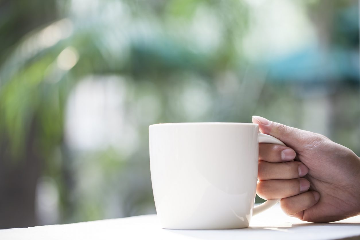 Person Holding Coffee Cup - soothe anxiety