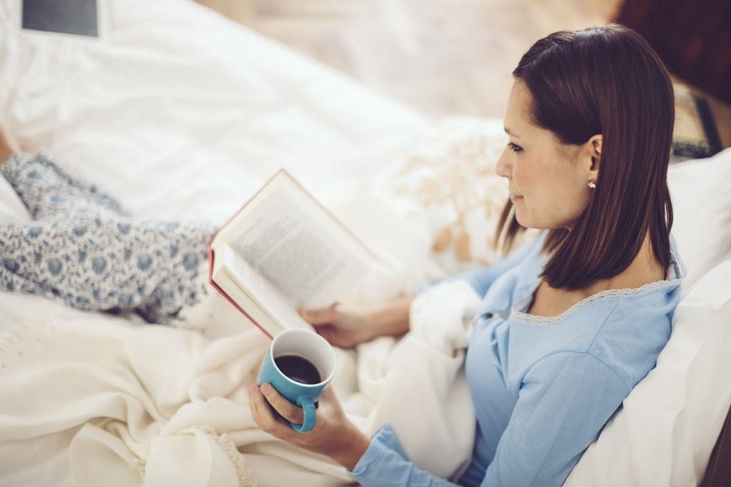 Woman reading - managing anxiety and stress