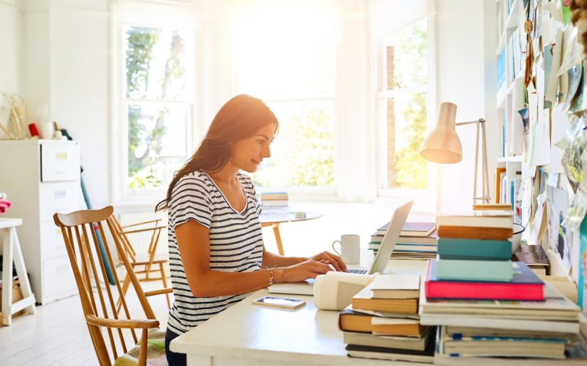 Indoor shot of a beautiful pregnant woman working at her modern home office.
