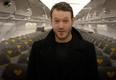 TC-Aaron-standing-speaking-to-camera-on-plane-1024x576