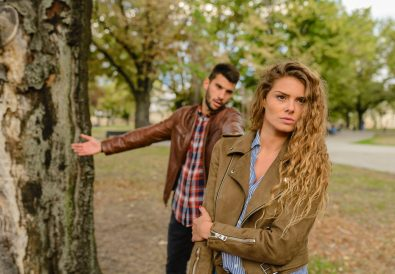 woman-and-man-wearing-brown-jackets-standing-near-tree-984954